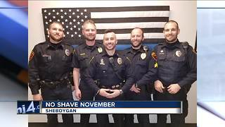 Police officers participate in No Shave November