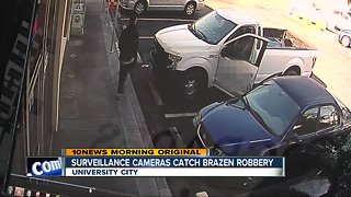 Surveillance cameras catch thief stealing from car
