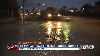 Heavy rain causes water to runoff from mountains into neighborhood