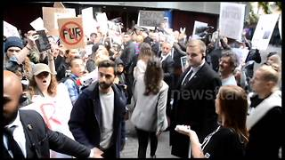 Animal rights activists protest outside London Fashion Week show - Video