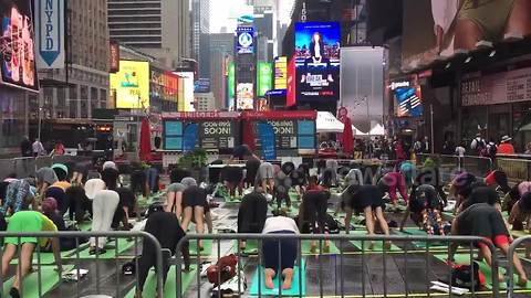 Yoga enthusiasts pack Times Square to celebrate summer solstice