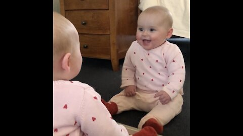 "Baby meets her ""identical twin"" for the first time in isolation"