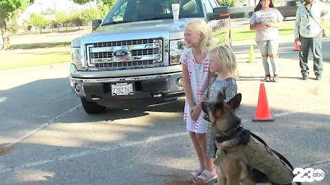 Community members accept dog food donations for local shelters in honor of K-9 Officer Jango