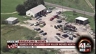 Search for accused cop killer moves north - Video