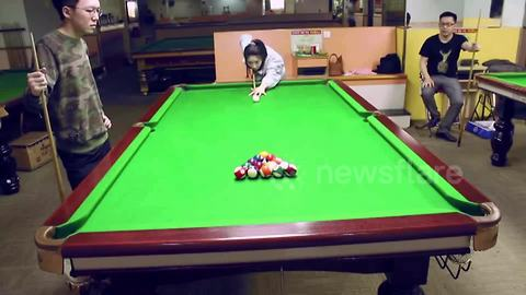 Talented Woman Clears The Pool Table With One Strike