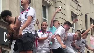 England Fans Dance on Bus Stop Canopy in Nottingham - Video