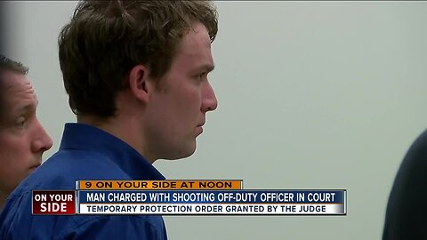 Man charged in shooting of off-duty police officer, son while hunting in court today