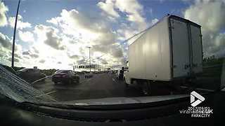 Driver encounters flying doors on motorway - Video