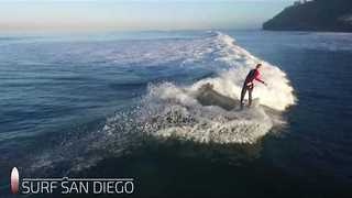 Scores of Surfers Majestically Catch Waves - Video