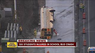 School bus overturns in crash with semi in Brooksville, six high school students injured - Video