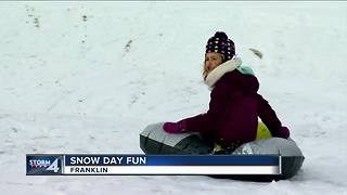 First big snowfall brings out sleds, tubes and skis - Video