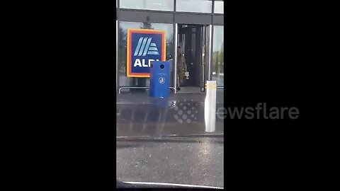 Funny moment man in leopard print gown walks out of Aldi with crate of beer