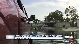 Residents Find Solutions to Fight Flood Waters - Video