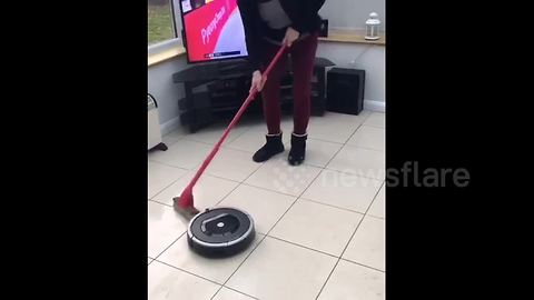 UK mum tries her hand at curling with a Roomba and the broom