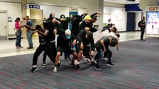 Dance Crew Entertains Passengers During A Long Flight Delay