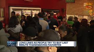 Long lines as people try to buy last minute thanksgiving favorites - Video