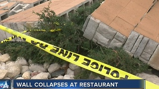 Wind blows down restaurant wall with customers inside - Video