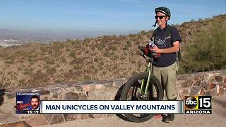 Valley man unicycles on mountain trails - Video