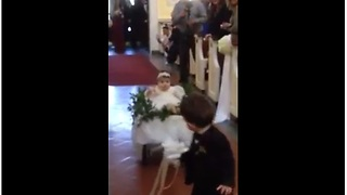 Ring Bearer Pulls Flower Girl Down The Aisle In Wedding Wagon - Video