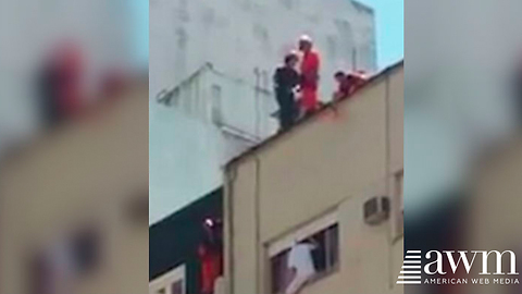 Footage Of Rescue Workers Jumping Off High-Rise Roof To Save Suicidal Man Goes Viral