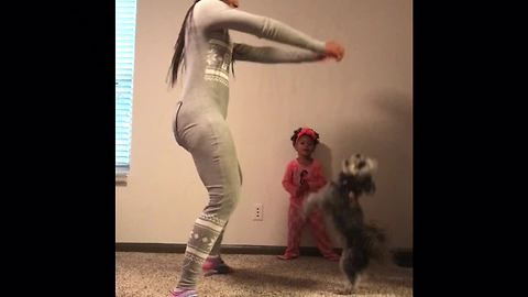 Mom, daughter & doggy have pajama dance party