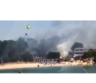 Brush Fire Sparks Evacuations at Ibiza Resort - Video