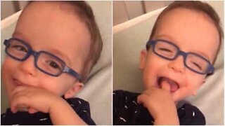 Baby wears glasses and sees clearly for the first time