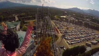 Thrilling roller coaster ride filmed from passenger seat