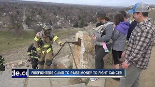 Firefighters climb to raise money for cancer treatment