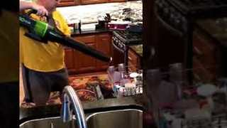 Wacky Dad Uses Leaf Blower to Dry the Dishes