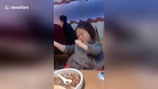 Excited Girl Dances After Having Her Favorite Soup In Restaurant In Shanghai