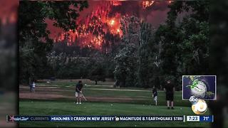 Golfing next to a raging fire? - Video