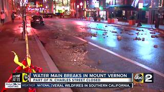 Water main break closes part of North Charles Street - Video
