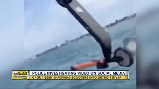 Viral video shows group throwing scooter into Detroit River