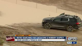 Police searching for carjacking,robbery suspect - Video