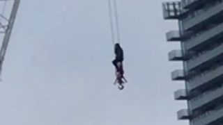 Firefighter Rescues Woman From Crane in Toronto - Video