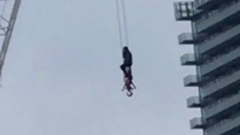 Firefighter Rescues Woman From Crane in Toronto