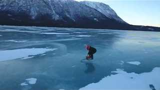 Ice-Skater Propels Himself Across Alaskan Lake Using Chainsaw - Video