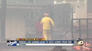 Friends use garden hose to save homes from West Fire - Video