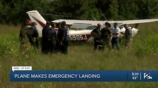 Plane makes emergency landing in field in southwest Tulsa