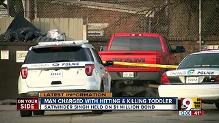 Man charged with hitting, killing toddler