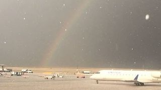 Rainbow Shines Over Denver Airport Following Hailstorm - Video