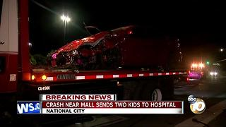 Crash near mall sends two kids to hospital - Video