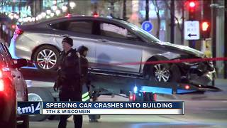 Suspect crashes into downtown Milwaukee business, fires multiple shots at police while fleeing scene - Video