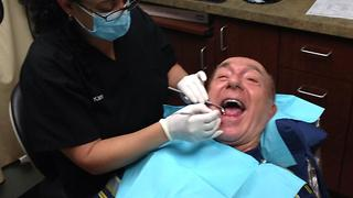 Boy films his father at the dentist. - Video