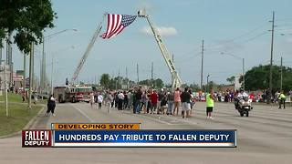 Hundreds pay tribute to fallen deputy - Video