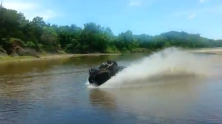 ATV rider crashes while speeding over river - Video