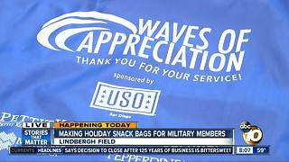 Making holiday snack bags for military members - Video