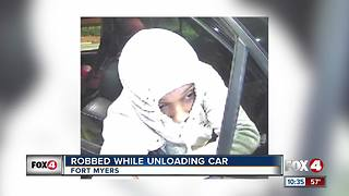 Woman Robbed While Unloading Her Car