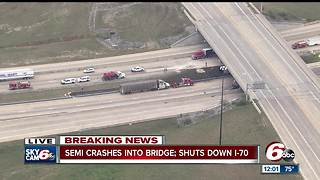Semi crashes into bridge, oil spilled on I-70 - Video